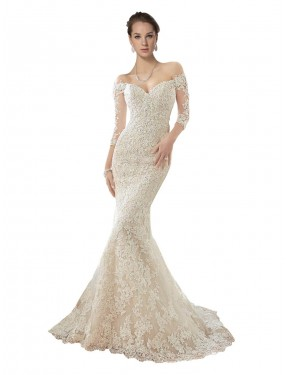 Shop Ivory & Champagne Mermaid Off the Shoulder Chapel Train Long Sleeves Lace & Tulle Wedding Dress Quebec